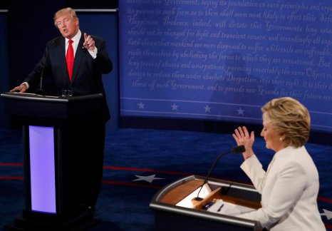 Republican U.S. presidential nominee Donald Trump speaks as Democratic U.S. presidential nominee Hillary Clinton listens during their third and final 2016 presidential campaign debate at UNLV in Las Vegas, Nevada, U.S., October 19, 2016. REUTERS/Mark Ralston/Pool