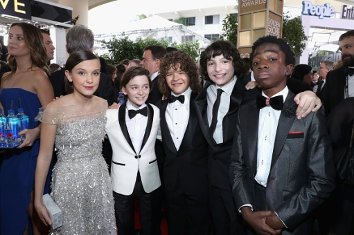 BEVERLY HILLS, CA - JANUARY 08: (L-R) Actors Millie Bobby Brown, Noah Schnapp, Gaten Matarazzo, Finn Wolfhard and Caleb McLaughlin at the 74th annual Golden Globe Awards sponsored by FIJI Water at The Beverly Hilton Hotel on January 8, 2017 in Beverly Hills, California. (Photo by Jonathan Leibson/Getty Images for FIJI Water)